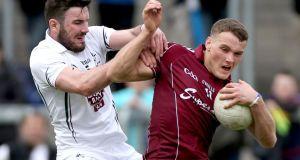 Galway's Seán Moran holds off Kildare's Fergal Conway during their All-Ireland under-21 football semi-final. Photograph: James Crombie/Inpho