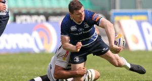 Leinster's Brian O'Driscoll offloads in the tackle at Stadio del Tricolore.  Photograph: Giuseppe Fama/Inpho