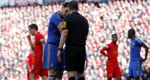 Chelsea's Branislav Ivanovic (left) shows his arm to referee Kevin Friend after an incident with Liverpool's Luis Suarez at Anfield. Photograph: Phil Noble/Reuters