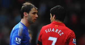 Branislav Ivanovic of Chelsea talks with Luis Suarez after the Liverpoolstriker appeared to bite the defender.  Photograph: Michael Regan/Getty Images
