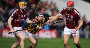 Kilkenny's Richie Hogan under pressure from Paul Killeen and Iarla Tannian of Galway at Semple Stadium.  Photograph: Cathal Noonan/Inpho