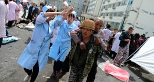 Injured people receive medical treatment at the People's Hospital after a strong magnitude earthquake hit Lushan county. Photograph: Reuters/Xinhua/Jiang Hongjing