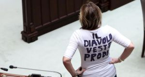 "Popolo della Liberta party deputy Alessandra Mussolini wears a T-shirt with a slogan that translates as ""The Devil wears Prodi"" as Italy's parliament voted for the president of the republic . Photograph: Franco Origlia/Getty Images"