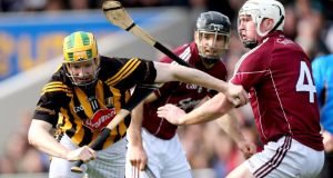 Kilkenny's Richie Power holds off the challenge of Galway's Niall Donoghue at Semple Stadium. Photograph: James Crombie/Inpho