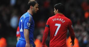 Luis Suarez and Branislav Ivanovic have words at half-time of yesterday's game – before the biting incident. Photograph:  Michael Regan/Getty Images.