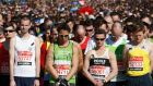 Runners observe a moment of silence before the start of the London Marathon. Photograph: Reuters/Luke MacGrego