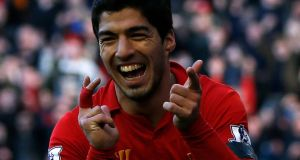 Liverpool's Luis Suarez celebrates his goal against Chelsea. Photograph: Phil Noble/Reuters