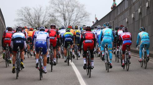 The peloton rides towards Bastogne.  Photograph: Bryn Lennon/Getty Images