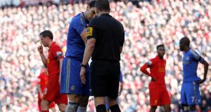 Chelsea's Branislav Ivanovic  shows his arm to referee Kevin Friend after an incident with Liverpool's Luis Suarez during their  Premier League soccer match at Anfield. Photograph: Phil Noble/Reuters