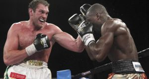 Tyson Fury lands a left hook on Steve Cunningham.