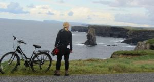 """I set out by hired bike along the north coast of the peninsula, my target for day one being the lighthouse at the tip, following a clifftop road, as magnificent as Moher but devoid of traffic."""