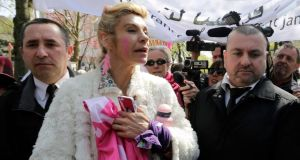 French humorist and television host Virginie Merle, also known as Frigide Barjot is escorted by security during the Manif pour Tous (Demonstration for All) protest march against France's planned legalisation of same-sex marriage in Paris on Sunday. Photograph: Reuters/Jacky Naegelen