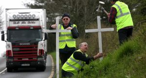 N4 Action Group campaigners erect the 30th cross on the N4 Dublin/Sligo road yesterday. Photograph: Brian Farrell