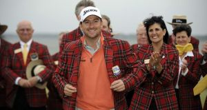 Graeme McDowell puts on his new plaid jacket after winning the RBC Heritage in Hilton Head Island, South Carolina. Photograph: Stephen Morton/AP