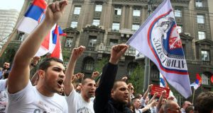 Protesters shouting slogans against the Kosovo accord in Belgrade yesterday. Photograph: Djordje Kojadinovic/Reuters