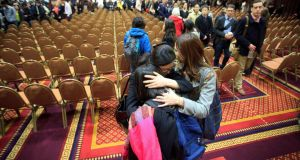 Students comfort each other after a memorial service for Lu Lingzi at Metcalf Hall in Boston University yesterday. Lingzi, a graduate student at the university, died in the Boston Marathon explosions. Photograph: Reuters