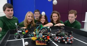 First year engineer students at UCD with some of their robots – pictured are from left Sean Totterdell, Aisling Drumgoole, Brian Feighan, Aideen Doyle, Niamh O Brien and James Greer. Photograph: Cyril Byrne