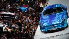 Visitors at the Shanghai Motors show visit the Mercedes-Benz stand. Photo: Reuters
