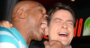 Mike Tyson, seen here pretending to bite Charlie Sheen's ear, reckons Luis Suarez and Branislav Ivanovic will laugh about all this one day.  Photograph: Getty Images