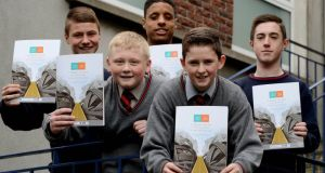 Students Ciaran Horan, Travis Fitzgerald, Addul Hajji, Kristian Hudson and Paul Cross from St Pauls CBS Secondary School Brunswick Street Dublin take a look at the report. Photograph:  David Sleator