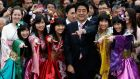 Japan's prime minister Shinzo Abe poses with members of Japanese idol group Momoiro Clover Z. Photograph: Reuters