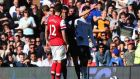 Olivier Giroud of Arsenal is sent off by referee Andre Marriner after a tackle on Stanislav Manolev of Fulham. Photograph: Mike Hewitt/Getty Images