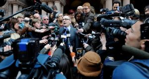 John Norris (C), the lawyer of suspect Raed Jaser, speaks to the media outside Old City Hall Court, following his client's brief appearance in court in Toronto. Photograph: Reuters