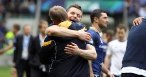 Leinster's Brian O'Driscoll and Joe Schmidt celebrate after winning last season's Heineken Cup final at Twickenham. Photograph: Inpho
