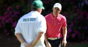 Rory McIlroy talks to his caddie JP Fitzgerald on the 13th green during the third round of the 2013 Masters Tournament at Augusta National. Photograph: Harry How/Getty Images