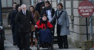 Marie Fleming pictured leaving the High Court last December with her partner Tom Curren and family members. Photograph: Cyril Byrne/The Irish Times