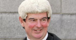 Mr Justice George Birmingham (above) ruled today that Gerry Burns, who was not present in court, was in contempt of a court order