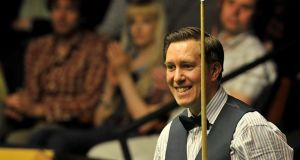 Dominic Dale in action against Judd Trump during his first round match of the Betfair World Championships at the Crucible, Sheffield.  Photograph:  Simon Cooper/PA Wire