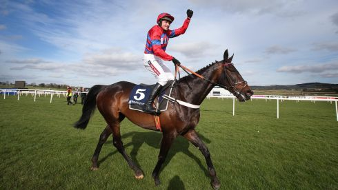 Barry Geraghty on Sprinter Sacre salutes the crowd after his win. Photograph: Lorraine O'Sullivan/Inpho