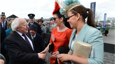President Michael D Higgins meets Emer Murphy and Rachael Holmes, (right) both from Naas, at the opening day of the Punchestown Festival. Photograph: Dara Mac Dónaill/The Irish Times
