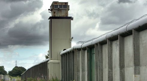 A watchtower and perimeter wall marks the of the former Maze Prison, west of Belfast.  Photograph: Paul McErlane/Bloomberg News