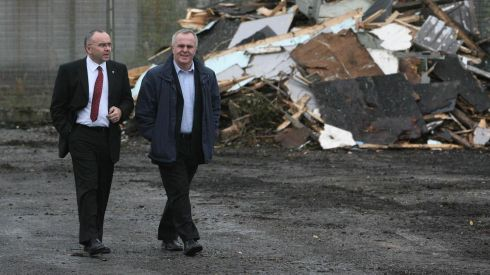 Sinn Féin's Paul Butler (left), and Raymond McCartney, former inmates, watch the beginning of demolition work on compound number 20 at the Maze Prison site in October 2006. Photograph: Niall Carson/PA