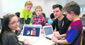 CoderDojo founder James Whelton with some young learners at a CoderDojo event