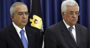 Salam Fayyad (left) with Palestinian president Mahmoud Abbas, who accepted his resignation this month as prime minister of the Palestinian Authority. Photograph: David Silverman/Getty Images
