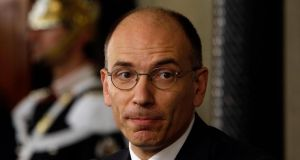 "Enrico Letta said he accepted the job knowing it was an enormous responsibility and that Italy's political class had ""lost all credibility"". Photograph: Gregorio Borgia/AP"