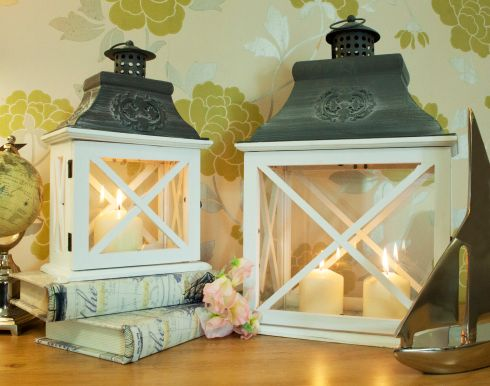 NIGHT LIGHT: This set of two Night Star lanterns, made of wood and glass with metal tops, can be used in living rooms or outside. The two-piece set (35cm by 22cm and 48.5cm by 31cm) is down from €79 to €49. They are available at  ezlivingfurniture.ie and at EZ Living's Limerick (061-412568), Castlebar (094-9286002), Galway (091-567040) and Swords (01-8135222) shops.