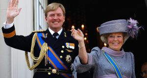 Netherlands' Queen Beatrix (R) and her son Crown Prince Willem-Alexander wave to well-wishers from the balcony of the Royal Noordeinde Palac. The Dutch will have their first king in more than 120 years when Willem-Alexander succeeds his mother.