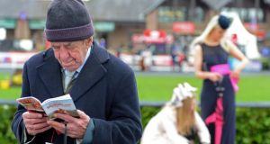 Paddy Hackett from Naas, studying the form, on the second day of the Punchestown Racing Festival.  Photograph: Eric Luke/The Irish Times