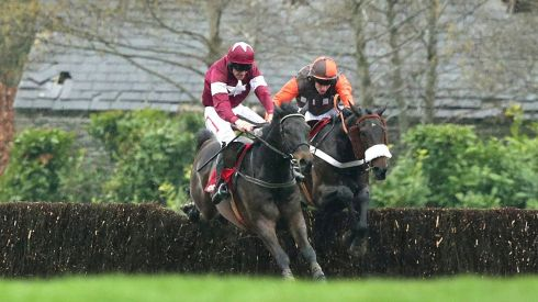 Davy Russell on Sir Des Champs (left) and Robert Waley-Cohen on Long Run at the last fence in the Punchestown Gold Cup. Photograph: Morgan Treacy/Inpho