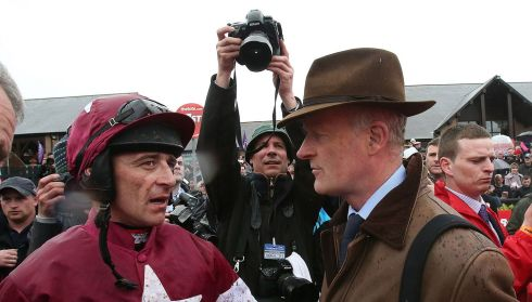 Davy Russell chats to trainer Willie Mullins (right) after winning the TheTote.com Punchestown Gold Cup Steeplechase on Sir Des Champs during Gold Cup Day. Photograph: Julien Behal/PA Wire