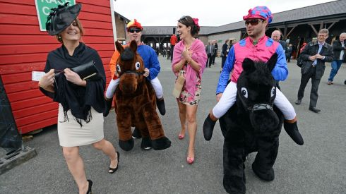 Aoibheann Smith, Abbeylara, Co Longford, and Mary Sheridan, Granard, Co Longford, with some clowns at Punchestown on day two.  Photograph: Eric Luke/The Irish Times