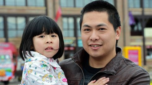 Guo Guo with his daughter Ruo (5) , of Kilcullen, at day two of the Punchestown  Festival 2013. Photograph: Eric Luke/The Irish Times