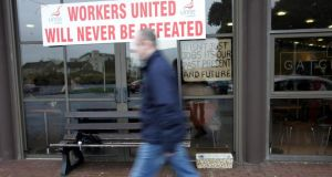 A man walks past the Waterford Crystal visitors centre during a protest in 2009.   Photograph: Eric Luke / The Irish Times