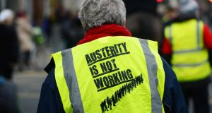A participant in an anti-austerity march in Dublin last November. Photograph: Alan Betson