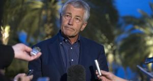 US Secretary of Defense Chuck Hagel speaks with reporters after reading a statement on chemical weapon use in Syria during a press conference in Abu Dhabi, United Arab Emirates. Photograph: Jim Watson-Pool/Getty Images.
