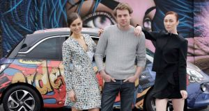 Derry designer JW Anderson with Opel Adam ambassador Rozanna Purcell (left) and model January Russell at the  launch of the Opel Adam at Hanover Quay, Dublin, yesterday.  Photograph: Mark Stedman/Photocall Ireland